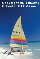 Jamaica Couple with Catamaran copyright M. Timothy O'Keefe - www.GuideToCaribbeanVacations.com