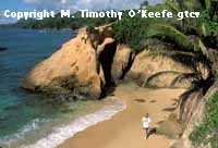 Tobago Woman Hiking Beach copyright M. Timothy O'Keefe - www.GuideToCaribbeanVacations.com