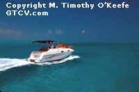 St. Thomas, USVI Speeding Boat copyright M. Timothy O'Keefe - www.GuideToCaribbeanVacations.com